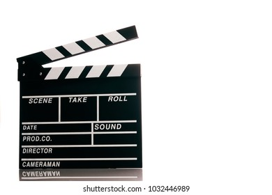 Clapper board isolated on white background with copy space. Movie production clapper board, close-up. Wooden black clapper board front view.