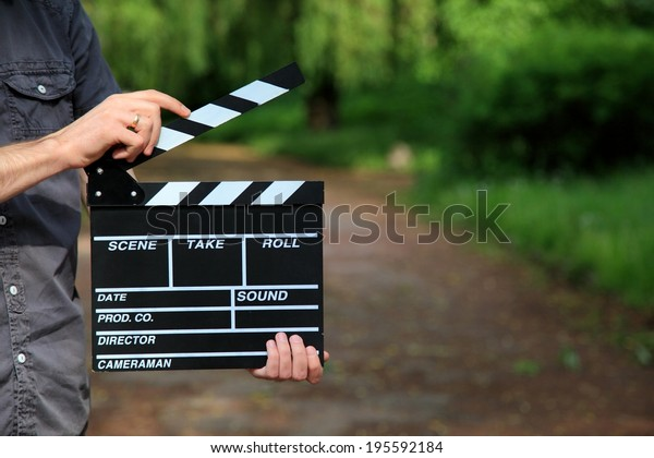 clapperboard in hand