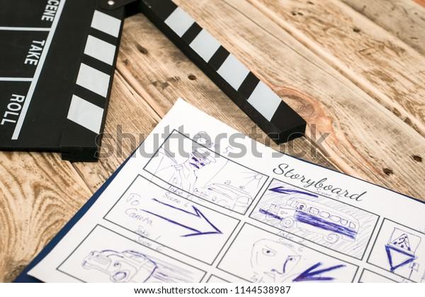 clapperboard, storyboard on wood