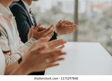 Clapping, congratulated the success of the organization. Successful business people teamwork. .The organization of conferences, event ,seminars, brainstorming.