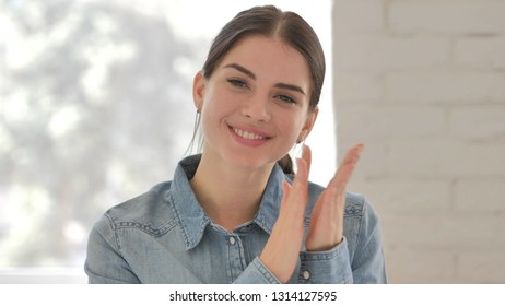 Clapping Young Girl Looking at Camera at Work, Applauding