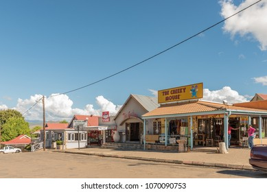 CLARENS, SOUTH AFRICA - MARCH 12, 2018: A street scene with an art gallery, a restaurant and a gift shop in Clarens in the Free State Province of South Africa