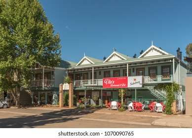 CLARENS, SOUTH AFRICA - MARCH 12, 2018: A street scene with the Vitos Restaurant and Pub in Clarens in the Free State Province of South Africa