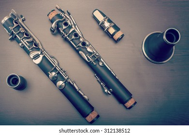 A clarinet dismantled, showings its parts on the table