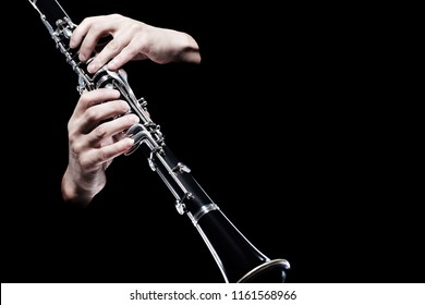 Clarinet player hands isolated. Woodwind classical music orchestra instruments closeup