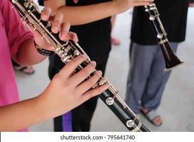 Clarinet player practice in school.