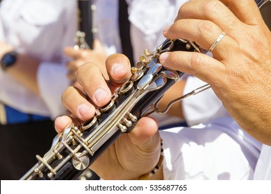 clarinet players during a concert in the street in Italy