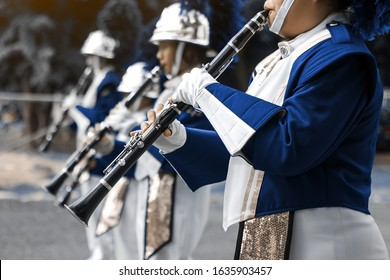 Clarinet school band performs in marching band