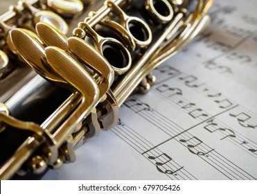 clarinet with sheet music,close shot of clarinet with sheet music