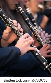 Clarinets of a town band during a performance.