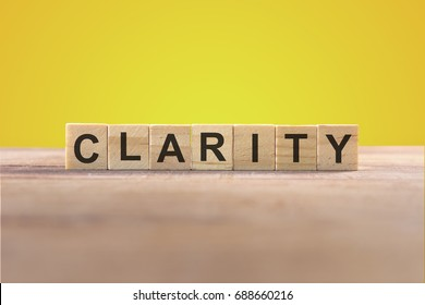 Clarity Word In Wooden Cube With Yellow Background