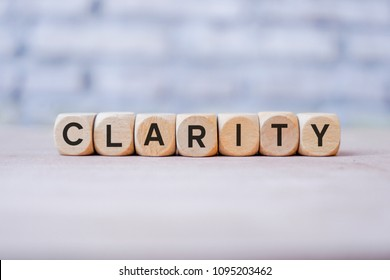 Clarity word written on wood block