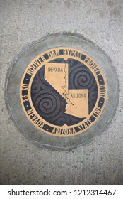 CLARK COUNTY, NEVADA - MARCH 3, 2014: A seal for the Hoover Dam Bypass Project is seen on the sidewalk of the bridge that overlooks the Hoover Dam on the walkway along US-93.