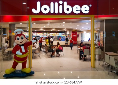 Clark, PH - JULY 2, 2018: Interior of Jollibee restaurant, the most popular fried chicken and fast foods franchise in Philippines, that decorating the giant red bee mascot at shop entrance.