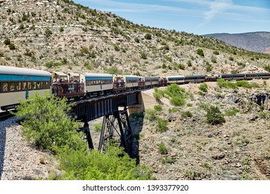 Clarkdale, Arizona, USA - May 4, 2019: Verde Canyon Railroad train driving on scenic route over a bridge