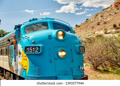 Clarkdale, Arizona, USA - May 4, 2019: Verde Canyon Railroad train engine and engineer driving on scenic route