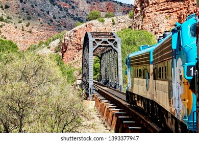 Clarkdale, Arizona, USA - May 4, 2019: Verde Canyon Railroad train engine driving on scenic route over a bridge