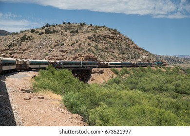 CLARKDALE, AZ – JULY 2.  Passengers aboard the Verde Canyon Railroad enjoy a scenic ride through Verde Canyon on July 2, 2017 at Clarkdale, AZ.