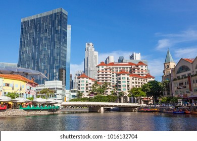 CLARKE QUAY, SINGAPORE - AUGUST 17, 2009: The Swissotel Merchant Court Hotel overlooking the Singapore River, with Clarke Quay on the left and skyscrapers in the background.