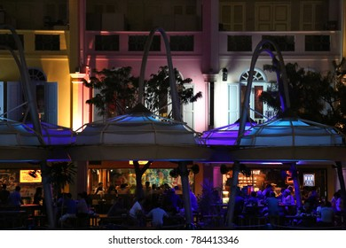 Clarke quay in Singapore. Many tourists boats on the river and restaurants illuminated on the quay. The picture has been taken on 6th august 2015.