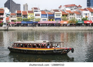CLARKE QUAY, SINGAPORE - MAY 11: Tourist boat cruising the Singapore river on May 11 2008 in Singapore. The Singapore River has been the centre of trade since Singapore was founded in 1819