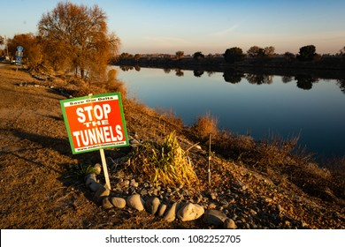CLARKSBURG, CA/U.S.A. - JANUARY 18, 2014: A sign protesting Governor Jerry Brown's plans to dig two tunnels through the San Joaquin River Delta is posted next to the Sacramento River.