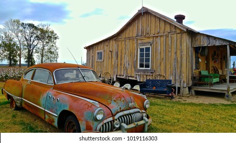 Clarksdale Mississippi USA, October 30, 2016. Old car & shack, with cotton field & tree's in background, at the Shacksdale Motel greeting Visitors and tourists from around the world