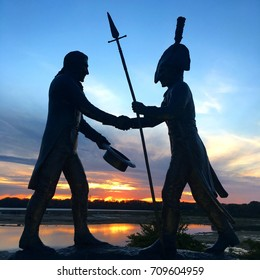Clarksville, IN, USA October 10, 2016 A statue of the meeting of Lewis and Clark stands against the sunset at the falls of the Ohio State park in Clarksville, Indiana