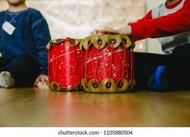 Class of music at school with children and teachers, percussion and drums