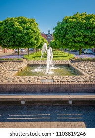 In the class neighborhood of 'De Riet' near the center of Almelo (The Netherlands) there is a fountain. The neighborwood with many small houses was built between the two World Wars for textile workers