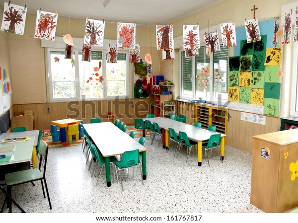 in a class of a nursery with drawings of children hanging