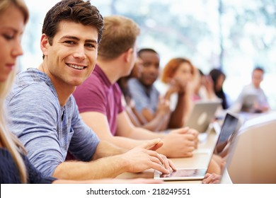 Class Of University Students Using Laptops In Lecture