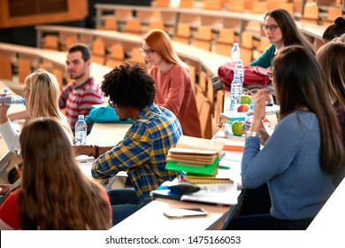 Class of university young students learning together