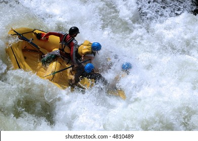 class V whitewater rapid with raft hitting the bottom of a 10' drop on the colorado river in gore canyon