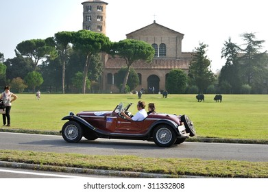CLASSE (RA), ITALY - SEPTEMBER 21: A red Alfa Romeo 4 R takes part to the GP Nuvolari classic car race on September 21, 2014 in Sant'Apollinare in Classe (RA). The car was built in 1968