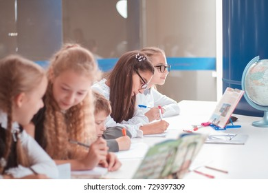 classes in creative children's school, girls and boys posing
