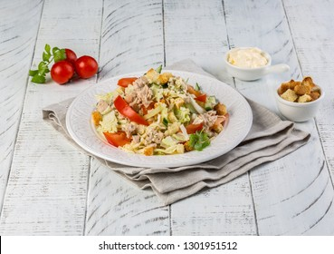 Classiacal Caesar salad with roasted chicken, eggs, lettuce, bacon, parmesan and tomatoes