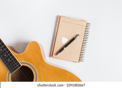Classic acoustic guitar and and note with pen  for composing