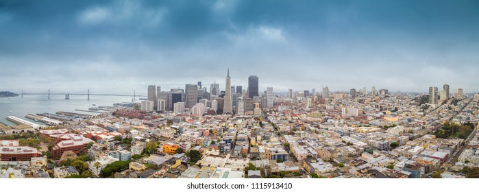 Classic aerial view of modern San Francisco skyline in summer with famous San Francisco fog rolling in seen from historic Coit Tower with retro vintage filter, San Francisco Bay Area, California, USA
