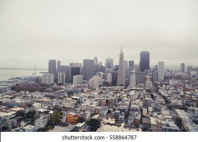 Classic aerial view of modern San Francisco skyline in summer with famous San Francisco fog rolling in seen from historic Coit Tower with retro vintage filter effect, SF  Bay Area, California, USA