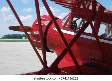 Classic Aircraft Biplane Red color with blue sky background
