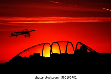 Classic aircraft at an international air show in sunset colors