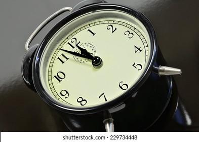 classic alarm clock, on black and gray background, close up /Alarm Clock