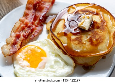 Classic american breakfast with egg, pancake and bacon