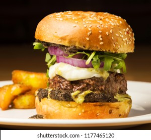 Classic american burger and fries on dark background