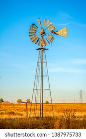 Classic Antique Rural Farm Windmill in a Field
