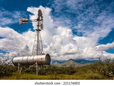 Classic antique Windmill with beautiful clouds as backdrop.