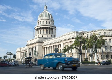 The classic architecture of the Capitolio building stands above the streets of Central Havana