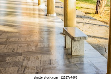 classic architecture outdoor garden interior with marble column alley way space for rest and walking and bench, environment in bright soft and white colors and beautiful light rays and shadows