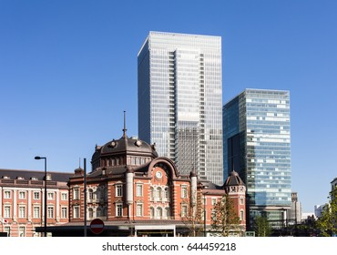 The classic architecture of the Tokyo JR train station contrasts with modern office building in the buisiness district of Marunouchi in Tokyo, Japan capital city.